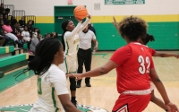 Junior Jayla McDougald hits one of her two three-pointers in Tuesday's loss to Seventy-First.
