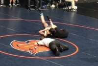 Ethan Owens (black shirt) earns a pin during the Holy Angels Tournament in Charlotte on his way to a second-place finish.