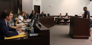 Gerard A. Morrison (right at podium) addresses the Rockingham City Council during Tuesday's meeting.