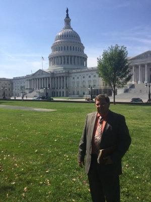The Rev. James Brigman stands outside the U.S. Capitol in 2017 after marching from Rockingham in hopes to get help for his medically fragile daughter.