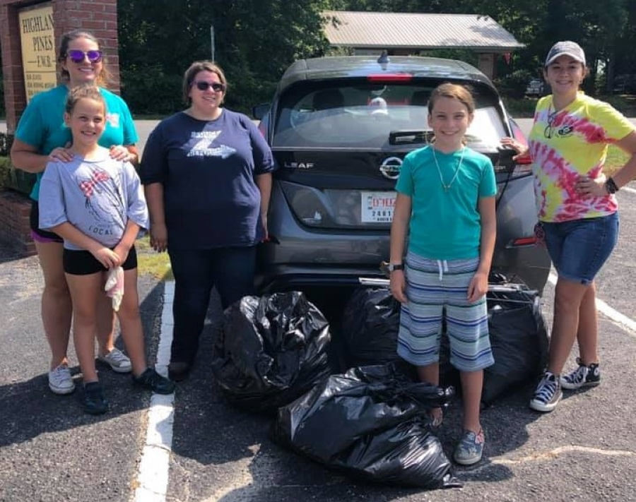Volunteers pose for a photo after collecting four bags of trash along Chalk and Freeman Mill roads on Saturday.