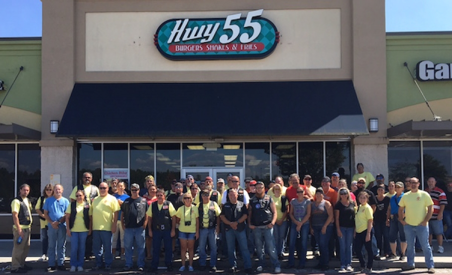 Riders in the Andy's Foundation charity ride pose for a photo outside of Highway 55 in Rockingham.