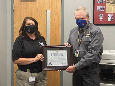 North Carolina Emergency Management Director Mike Sprayberry presents an award to Donna Wright on her retirement as Richmond County Emergency Services director.