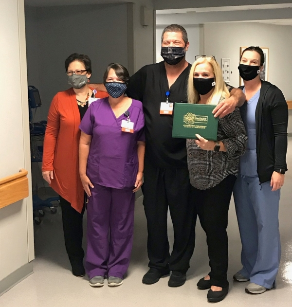 From left to right: Deanna Kearns, R.N., Administrative Director, Corporate Education & Professional Development; Tammy Hussey, R.N., Clinical Nurse Leader, First Surgical; Jason Grooms, R.N., Karen Robeano, DNP, R.N., Chief Nursing Officer; and Shannon Smith, R.N., Administrative Director, Med/Surg.