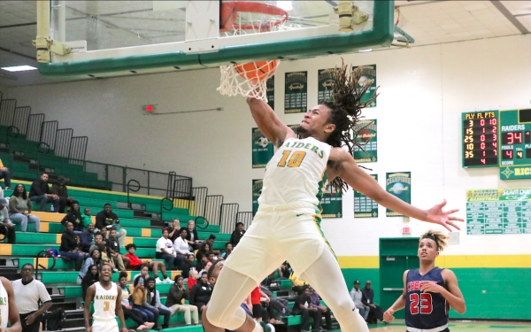 Junior Nygie Stroman slams home a dunk for two of his team-high 17 points in Richmond's win over Cheraw.