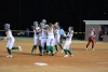 The Lady Raiders swarm freshman Payton Chappell following her two-run walk-off single in the bottom of the seventh inning in Friday's 9-8 senior night win over Scotland.