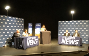 Participants in the Hometown Debate on health care costs Oct. 2 in Salisbury, sponsored by the N.C. Institute of Political Leadership. From left, former Rep. Bill Brawley, R-Mecklenburg, Rep. Carla Cunningham, D-Mecklenburg, Spectrum News anchor and host Loretta Boniti, Brendan Riley of the N.C. Justice Center, and Jordan Roberts of the John Locke Foundation.