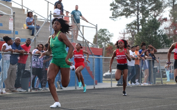 Junior Jakerra Covington, racing in the 100-meter dash, won three events in the team's meet at Scotland.