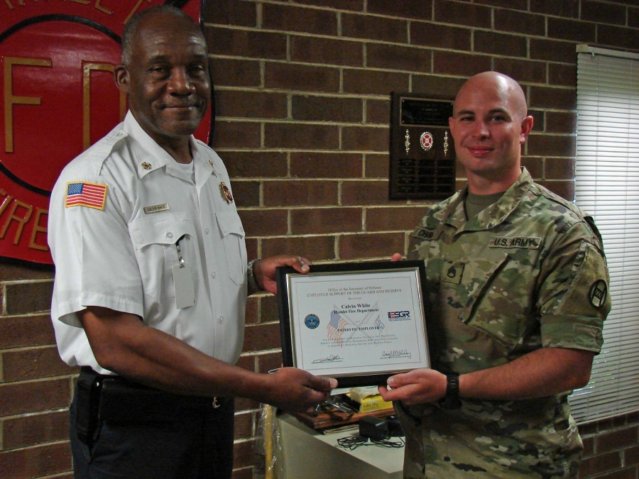 Hamlet Fire Chief Calvin White was recently presented with the Patriot Award by Employer Support of the Guard and Reserve for his  support of Staff Sgt. Gary Chavis.