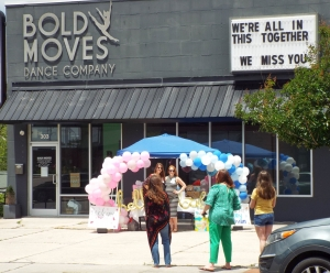 Guests pull up to a drive-by baby shower for Holly Howe and Sarah Phillips of Bold Moves Dance Studio.