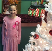 "Jenna Stables, 8, of Hamlet, was the winner of Hamlet Public Library's ""Great Stocking"" giveaway."