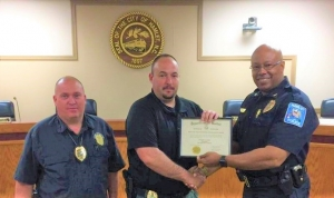 Hamlet Police Chief Tommy McMasters, right, presents Detective Sgt. Chris Lampley with his Intermediate Law Enforcement Certificate on Wednesday, along with Detective. Capt. Randy Dover.