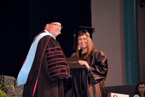 Cierra Locklear of Rockingham accepts her diploma from Dr. Dale McInnis, president of Richmond Community College, during graduation on May 11.