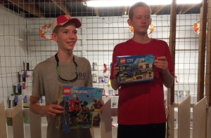 Austin and Hayden Hadinger pose with their Lego prizes following their first and second place finishes. (Not pictured: Reece Gentry)