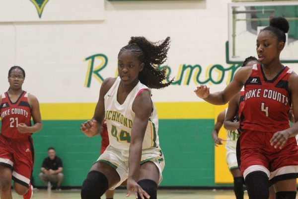 Sophomore forward Jakerra Covington (44) had a double-double (15 points, 11 rebounds) in Richmond's win over Hoke County.