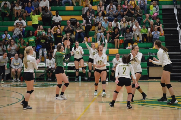 The Lady Raiders celebrate a point during the third set of Thursday's sweep over Scotland on senior night.