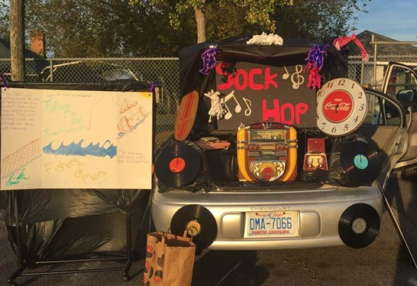 A car decorated with a jukebox and records sits outside Place of Grace Oct. 31 for its '50s on the Hill fall festival.