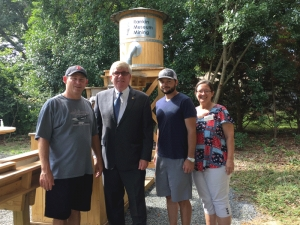 Pictured in the photo from left to right: Julian Carter (Board member), Sen. Tom McInnis, Brett Webb (Board member), and Karen Brewer (Board member)