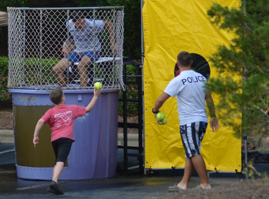 BLET student Justin Freeman prepares to take a dive in the dunking booth during National Night Out. See more photos and video at the Richmond Observer's Facebook page.