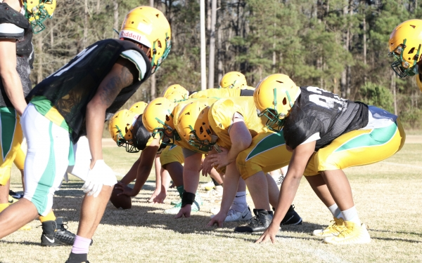 Members of the Richmond special teams units lineup for a play during a practice this winter.