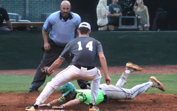 Rising senior Luke Preslar slides under the tag in the top of the sixth inning in Tuesday's win over Pinecrest.
