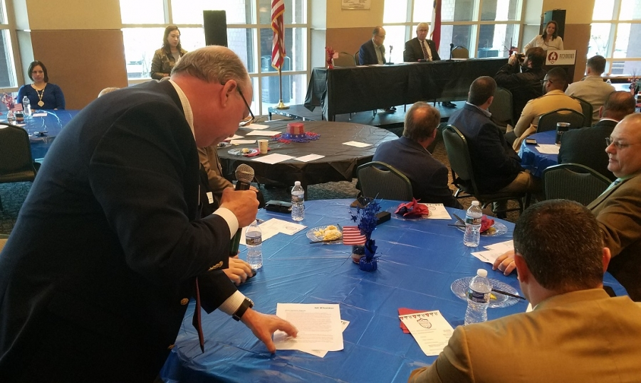 Richmond Community College President Dr. Dale McInnis asks Rep. Ken Goodman and Sen. Tom McInnis about funding during the Chamber of Commerce's Legislative Breakfast on Monday.