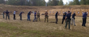 Law enforcement officers are participating in tactical rifle training exercises.