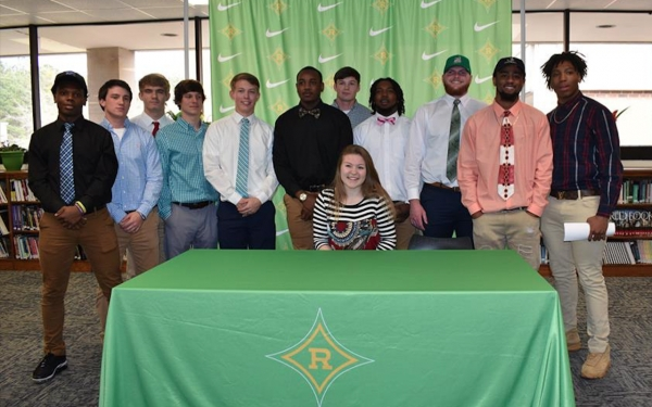 A total of 12 Richmond student-athletes signed their NLIs to play collegiate athletics Wednesday in the school's media center.