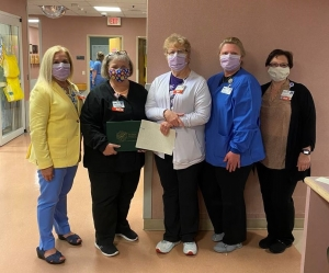 Pictured (left to right): Karen Robeano, DNP, R.N., Chief Nursing Officer, Juanita Bethune, R.N., Patient Placement Coordinator, Kay Boroughs, R.N., Director of Patient Flow, DeeAnna Johnson, R.N., Administrative Director, Emergency Department and Patient Flow and Deana Kearns, R.N., Administrative Director, Corporate Education/Clinical Practice.