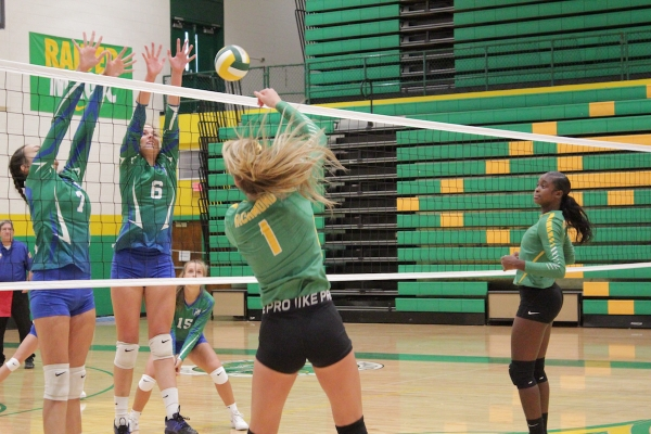 Senior outside hitter Jadyn Johnson (1) delivers a kill in Wednesday's scrimmage.