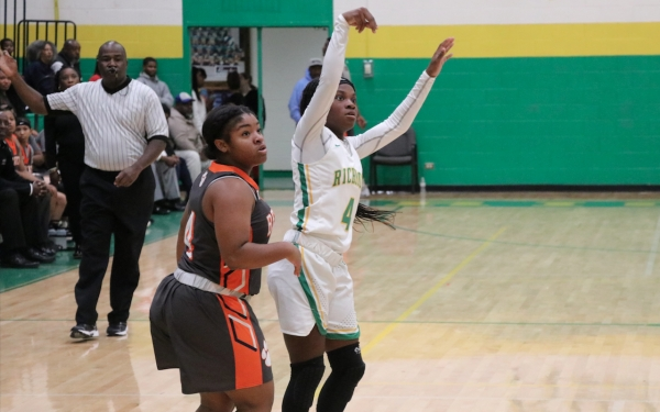 Junior point guard Jayla McDougald watches as she hits a three-pointer during Tuesday's 30-point win over Anson.