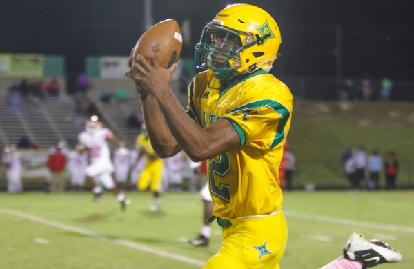 Junior wide receive Malik Stanback catches what would be an 86-yard game-winning touchdown in Friday's 25-19 win over Seventy-First High School.