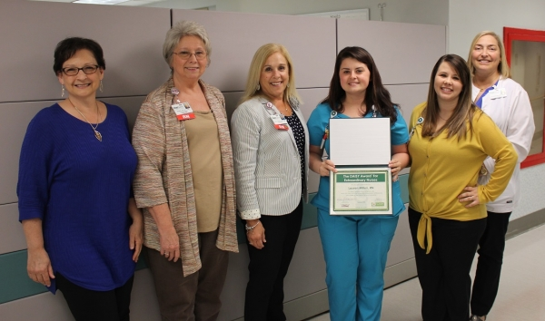 Congratulations to Lauren Millen, R.N., February 2019 DAISY Award Winner for FirstHealth of the Carolinas. Millen (holding the certificate) is pictured with (from left to right) Deana Kearns, MSN, R.N., administrative director of corporate education and clinical practice; Debbie Brand, R.N., magnet coordinator; Karen Robeano, DNP, R.N., chief nursing officer and vice president of patient care services; Morgan Scott, R.N., MRH-Richmond nurse manager of medical/surgical unit; and Allison Duckworth, R.N., nursing executive for MRH-Richmond.