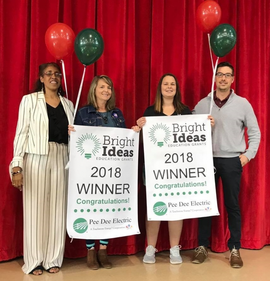 "Two teachers at West Rockingham Elementary were recently awarded Bright Ideas grants from Pee Dee Electric. Pictured, from left: Willette Surgeon, principal; Tonya Baldwin; Rebekah Burleson; Seth Allen, Pee Dee Electric. Baldwin won a Bright Ideas grant for her ""Kindergarten 'Take-Home' Math Baggies,"" and Burleson for her ""Are you in the Zone?"" fitness testing software and equipment."