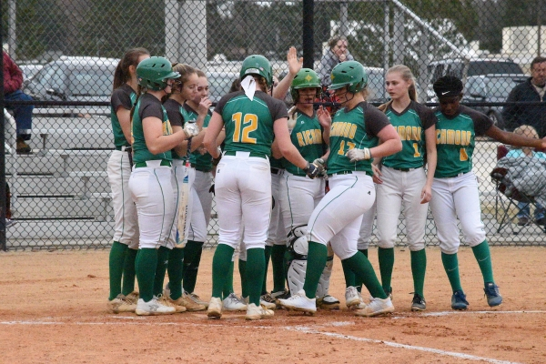 Greyson Way (17) is greeted by teammates following her 32nd career home run, Richmond's new program record.