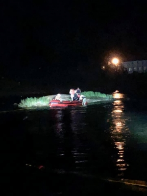 Crews from Cordova Fire and Rescue, Ellerbe Rescue and Rockingham Rescue respond to the aid of two teenage girls stranded on a rock on the south side of Blewett Falls late Sunday night.