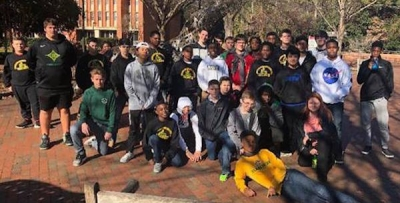 Raider wrestling teams experience college tournament at N.C. State