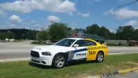 """Choose Your Ride"" Campaign Symbolized by ""Taxi"" Police Car"