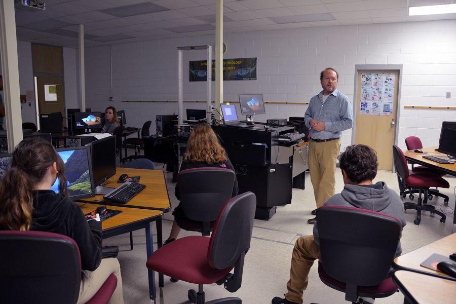 Richmond Community College Information Technology instructor Lance Barber talks to Ellerbe Middle School students about careers in IT and Cybersecurity.