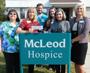 Beverly Thompson, Secretary, WoodmenLife (Wallace, SC Chapter 966); Joan Pavy, Administrator of McLeod Hospice & Palliative Care; Butch Boan, McLeod Hospice Nurse; Hannah Bragg, Departmental Secretary for McLeod Hospice; Gloria Lewis, President, WoodmenLife (Wallace, SC Chapter 966) and Louise Talbert, Clinical Nurse Manager, McLeod Home Health and Hospice.