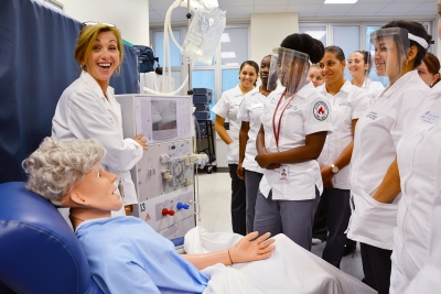 Dialysis Technology instructor Robyn Davis uses a simulation manikin to demonstrate a procedure with her students at Richmond Community College.
