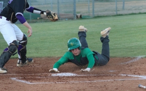 Senior Tyler Bass slides across home plate in the top of the first of Friday's win over Jack Britt.