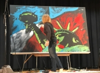 Speed painter Stephanie Burke puts finishing touches on her two-canvas Statue of Liberty painting Tuesday.