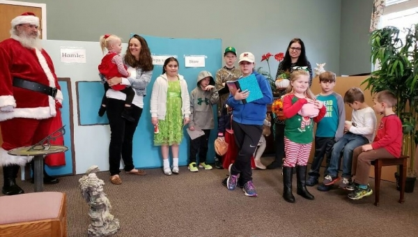 A group of kids at the Hamlet Public Library on Wednesday put on a play about discovering the best things about Christmas.