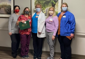 From left: Deana Kearns, R.N., administrative director, corporate education and professional development; Justyna Iskrzycki, R.N.; Kay Boroughs, R.N.; Karen Robeano, DNP, R.N., chief nursing officer and vice president, patient care services; and Dee Anna Johnson, R.N., administrative director, transfer center.