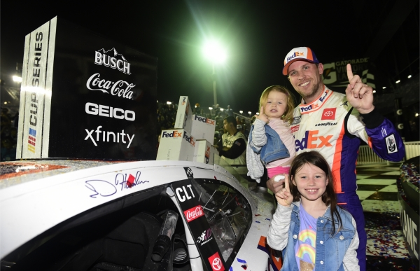 Denny Hamlin, driver of the #11 FedEx Express Toyota, affixes the winner's decal on his car in Victory Lane after winning the NASCAR Cup Series 62nd Annual Daytona 500 at Daytona International Speedway on February 17, 2020 in Daytona Beach, Florida.