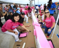Jimmie Johnson and fellow NASCAR drivers team with breast cancer survivors to paint pit wall pink