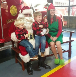 Brothers Eli and Kyle Sachs pose with Jolly Ole St. Nick during Saturday's Breakfast with Santa at the Hamlet Fire Department.