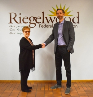 REV President and CEO, Jason Lee, and Riegelwood Federal Credit Union president and CEO, June Bigford.
