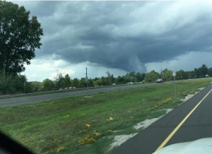 A funnel cloud emerges along US Highway 220 North near Exit 23 at 2:30 p.m. Friday.